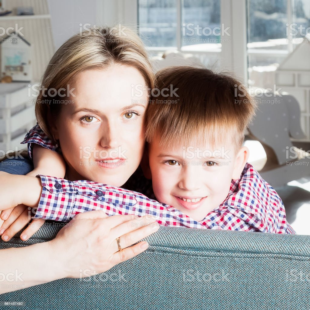 Portrait of mother and son in the room stock photo