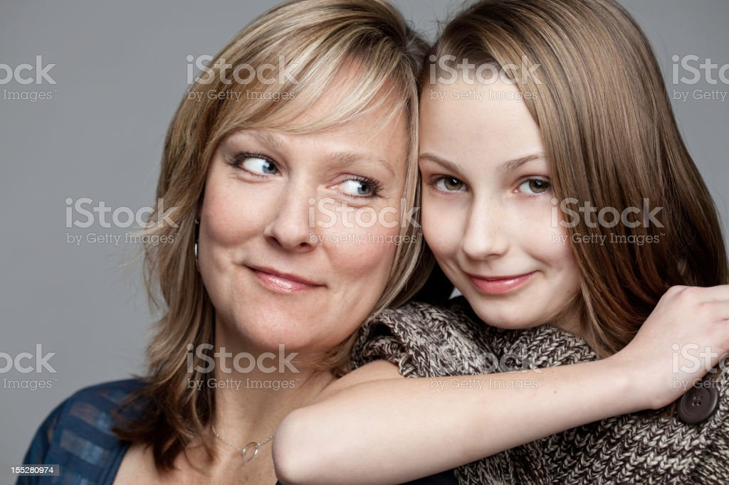 Portrait of mother looking at young daughter royalty-free stock photo