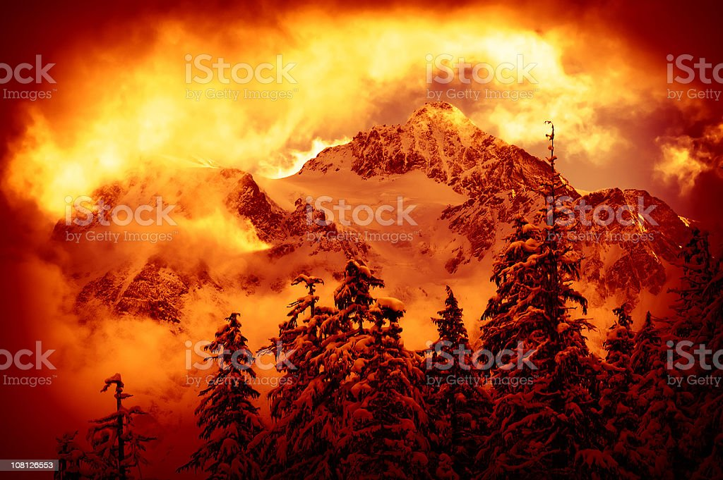 Portrait of Mountains and Forest Covered in Snow, Red Toned royalty-free stock photo