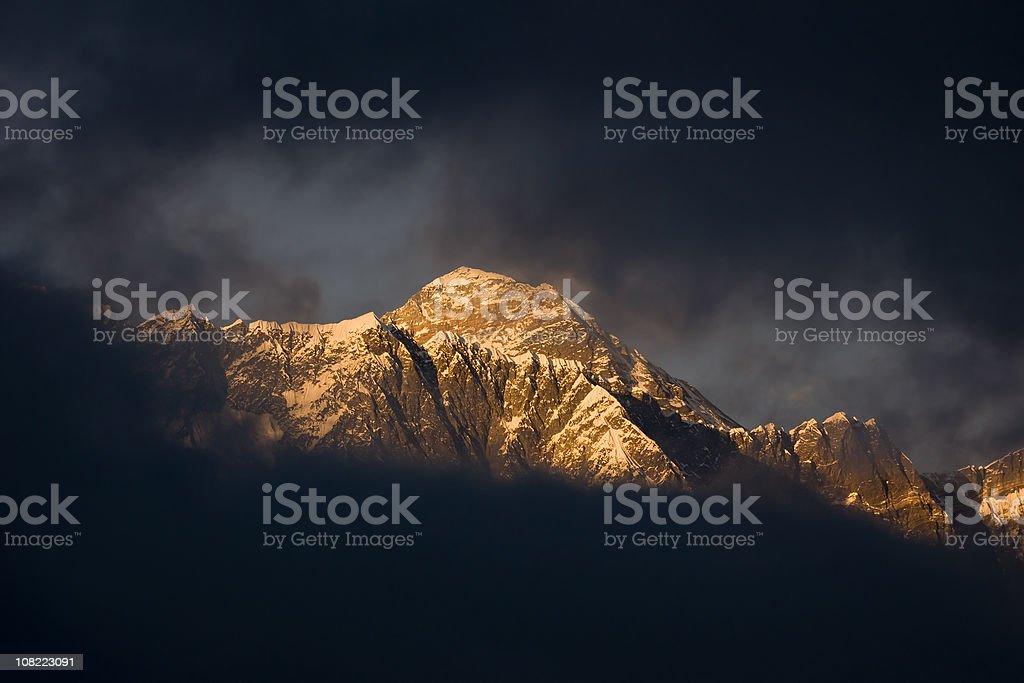 Portrait of Mt Everest Through Dark Clouds stock photo