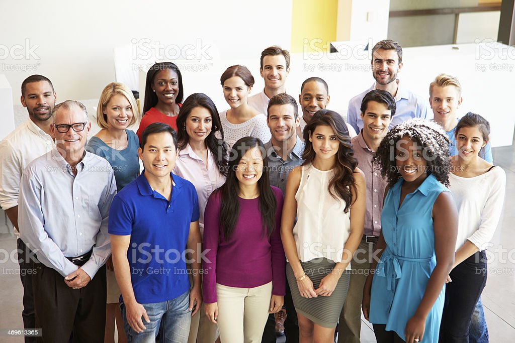 Portrait Of Multi-Cultural Office Staff Standing In Lobby stock photo