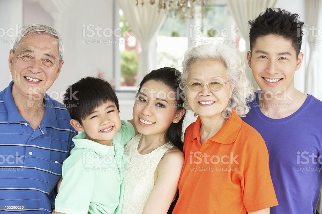 Portrait Of Multi-Generation Chinese Family Relaxing At Home royalty-free stock photo