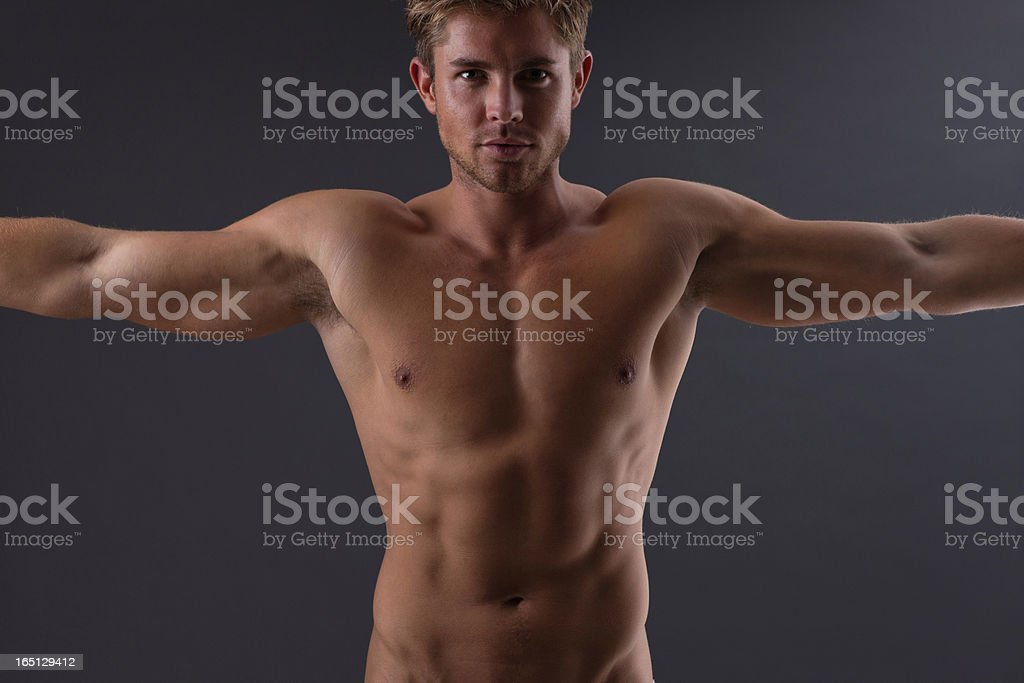 Portrait of muscular man with arms outstretched royalty-free stock photo