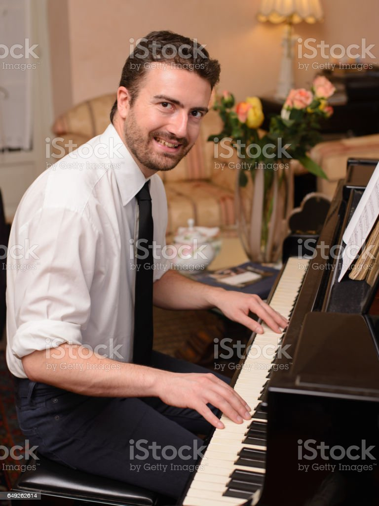 Portrait of music performer playing his piano stock photo