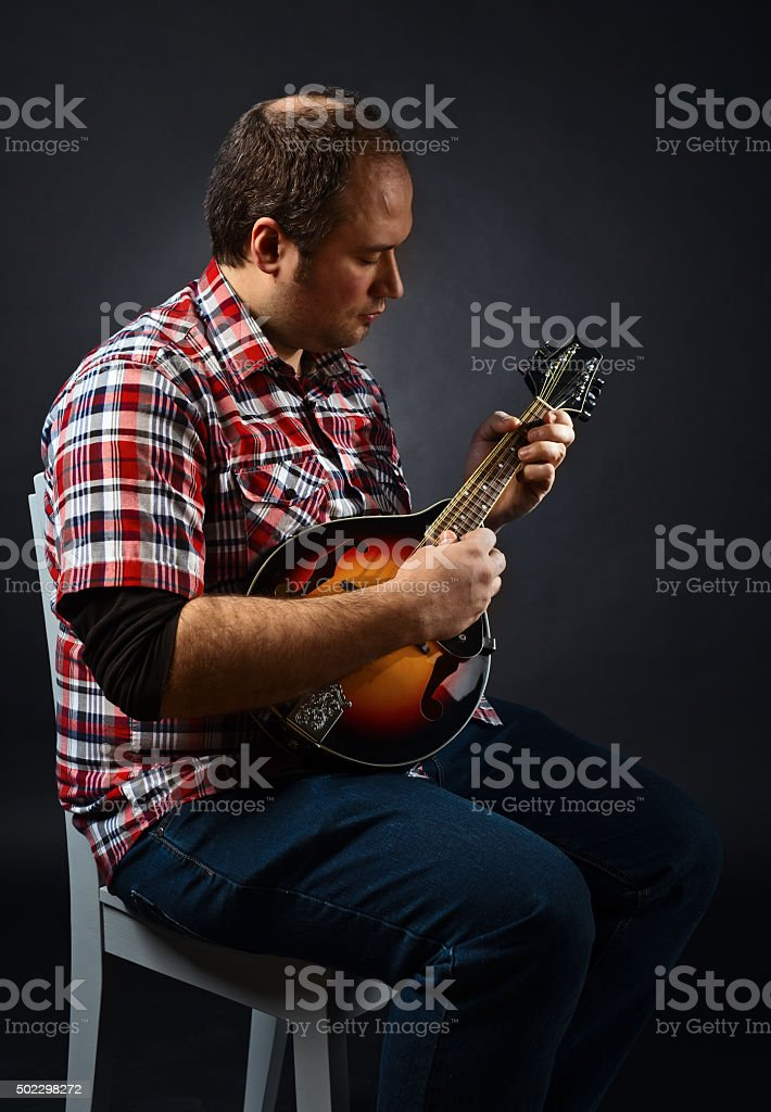 portrait of musician with mandolin stock photo