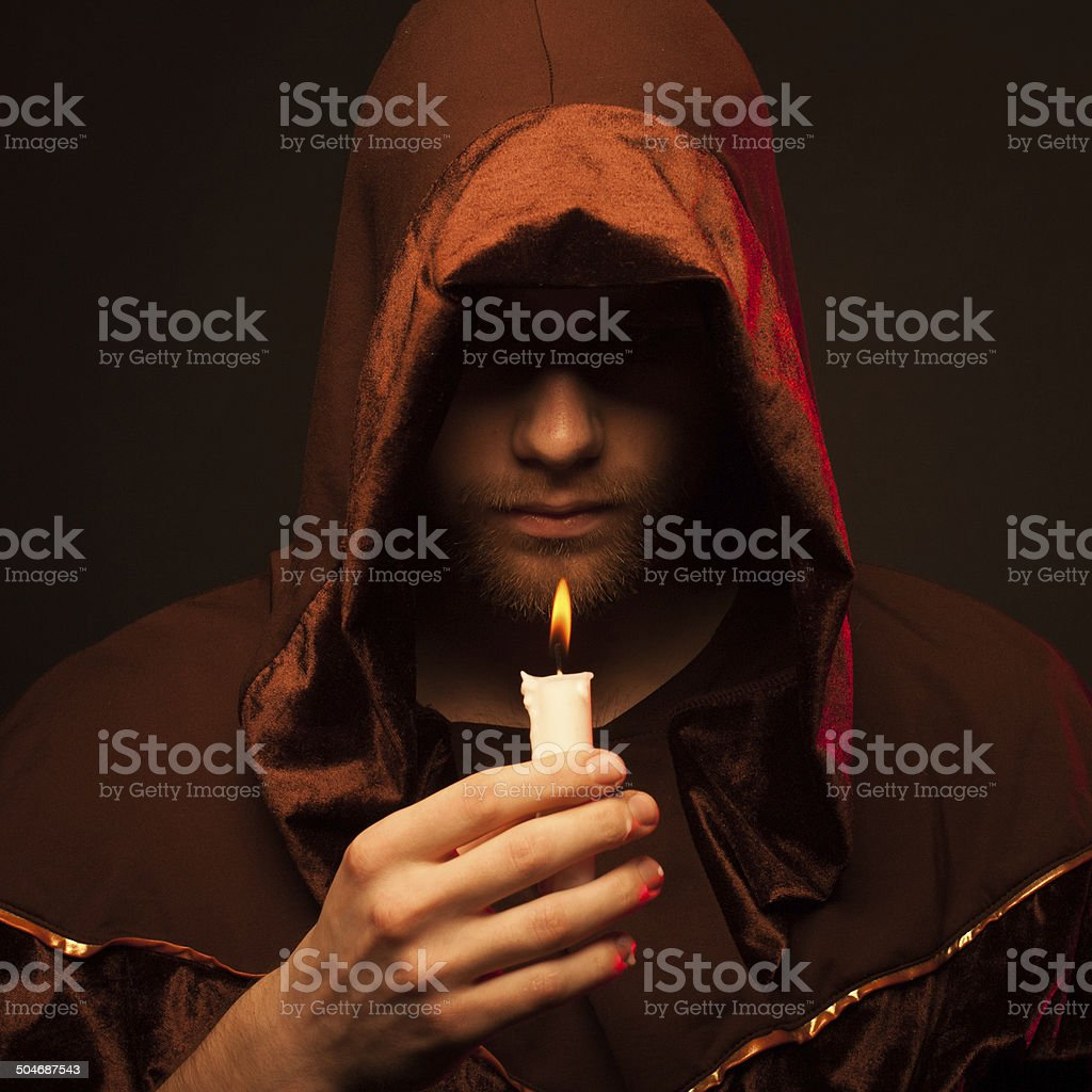 Portrait of mystery unrecognizable monk stock photo
