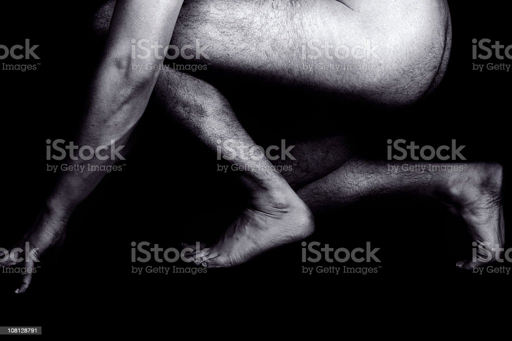 Portrait of Naked Crouching Male, Black and White stock photo