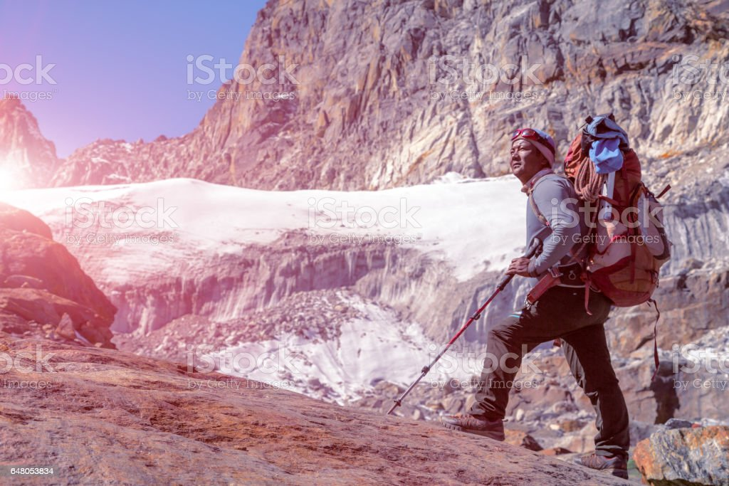 Portrait of Nepalese Mountain Guide staying on Glacier Sunny stock photo