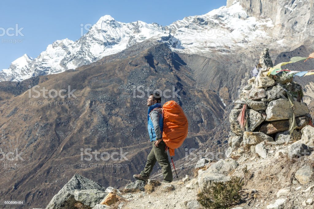 Portrait of Nepalese professional Mountain Guide staying on Footpath stock photo