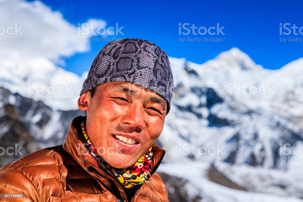 Portrait of Nepali Sherpa, Mount Makalu on background, Nepal stock photo