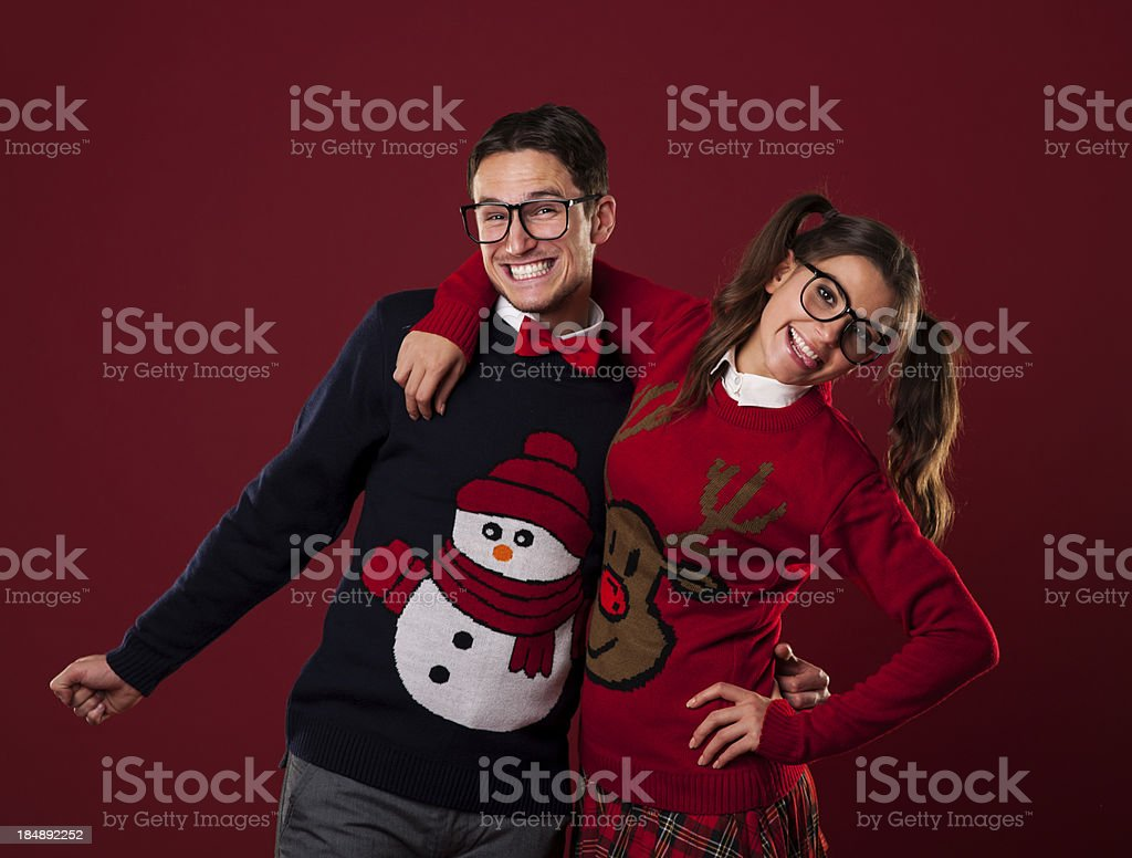 Portrait of nerd couple wearing funny sweaters royalty-free stock photo