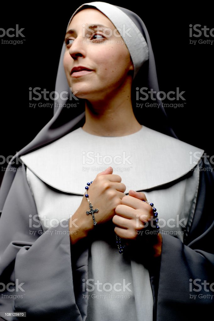 Portrait of Nun Holding Rosary Beads stock photo