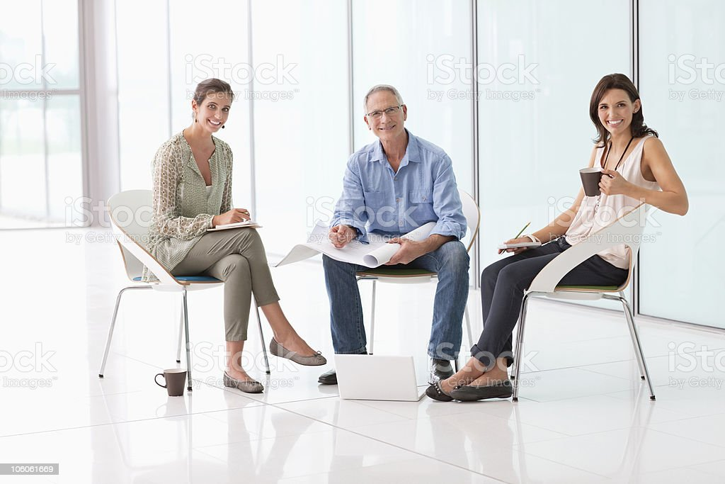 Portrait of office colleagues with blueprints royalty-free stock photo