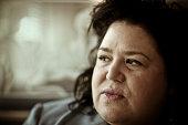 Portrait of old fat pensive woman