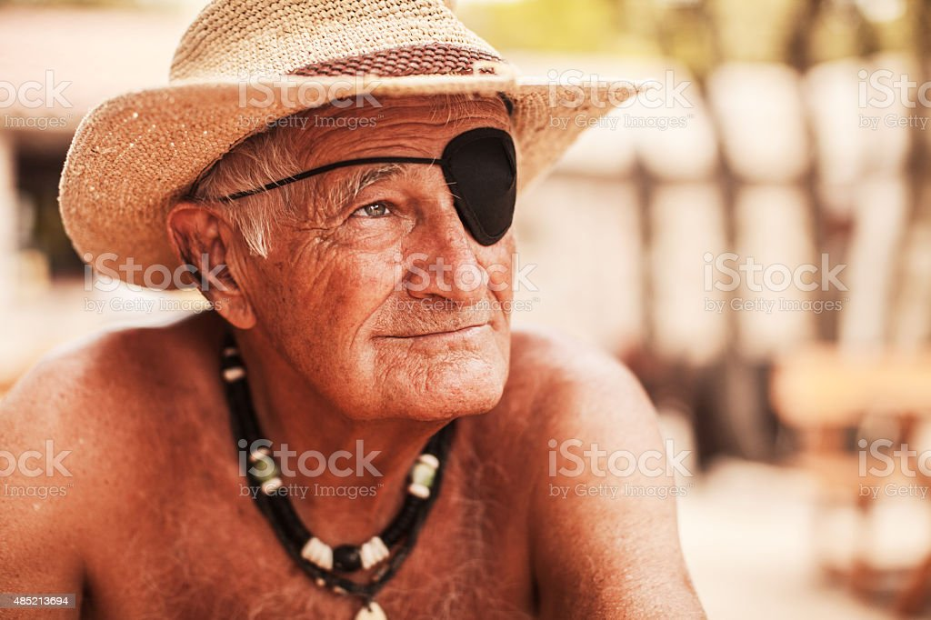 Portrait of old man with eye patch stock photo
