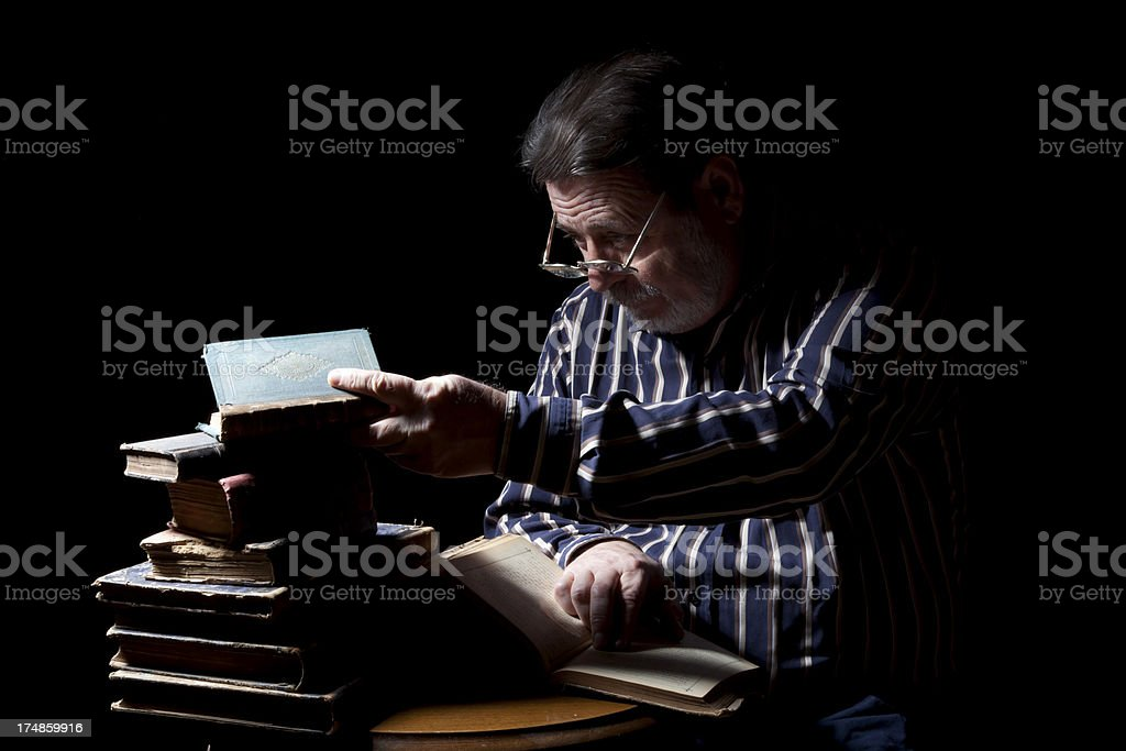 Portrait of Old Man With Reading Book stock photo
