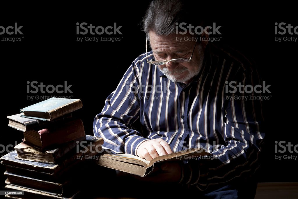 Portrait of Old Man With Reading Book royalty-free stock photo