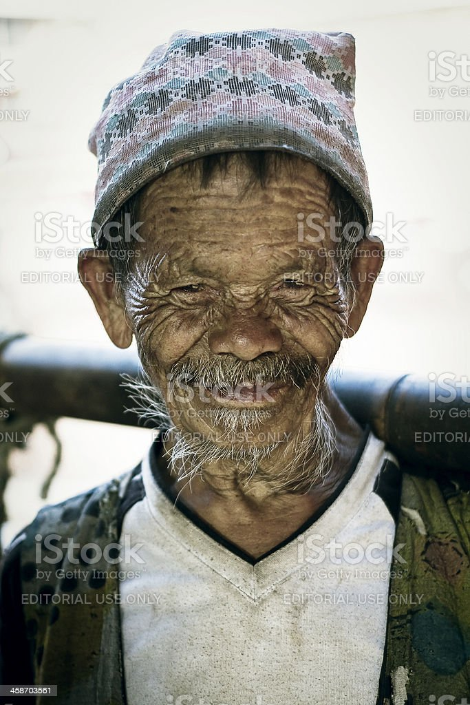 Portrait of old Nepali man looking at the camera stock photo