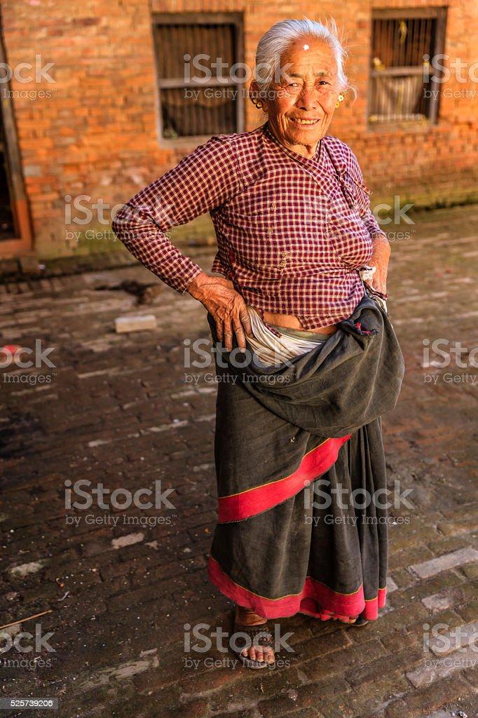 Portrait of old Nepali woman in Bhaktapur, Nepal stock photo