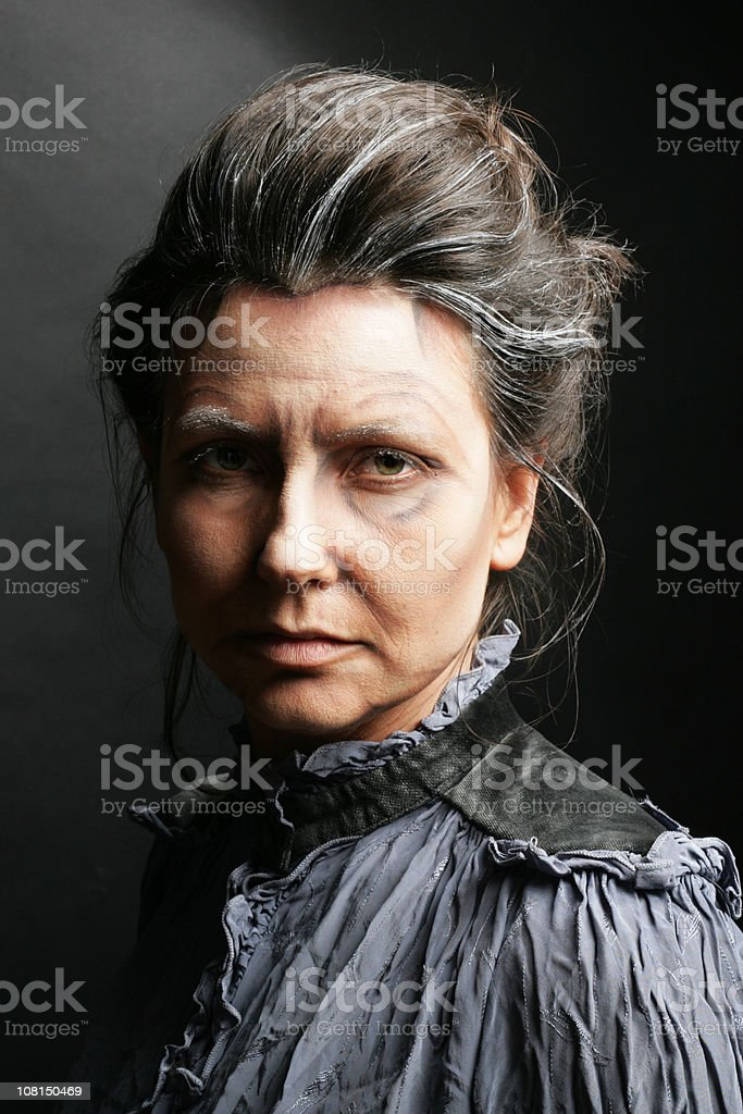Portrait of Old, Scary Woman Dressed in Antique Clothing stock photo