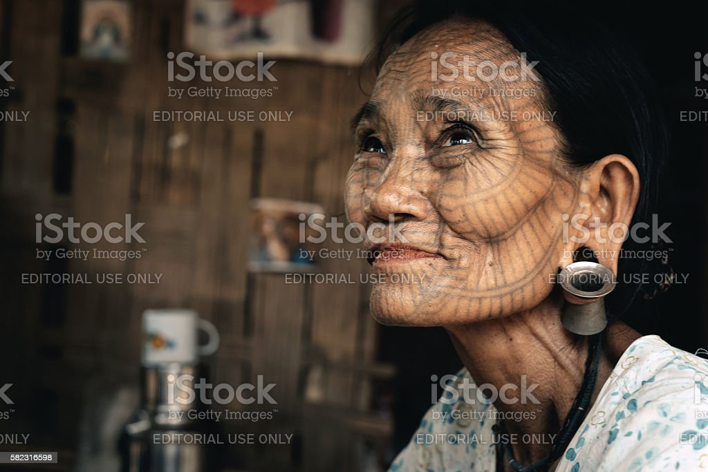 Portrait of old tattooed woman, Myanmar stock photo