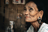 Portrait of old tattooed woman, Myanmar