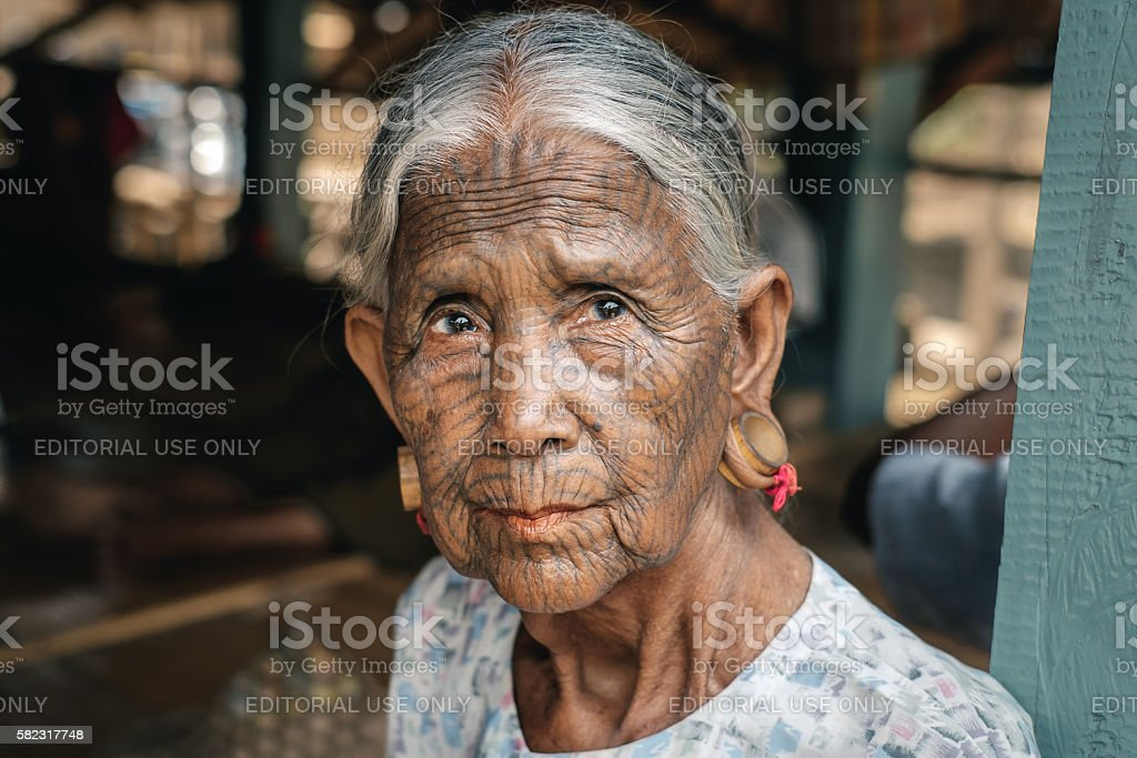Portrait of old tattooed woman, Myanmar stock photo