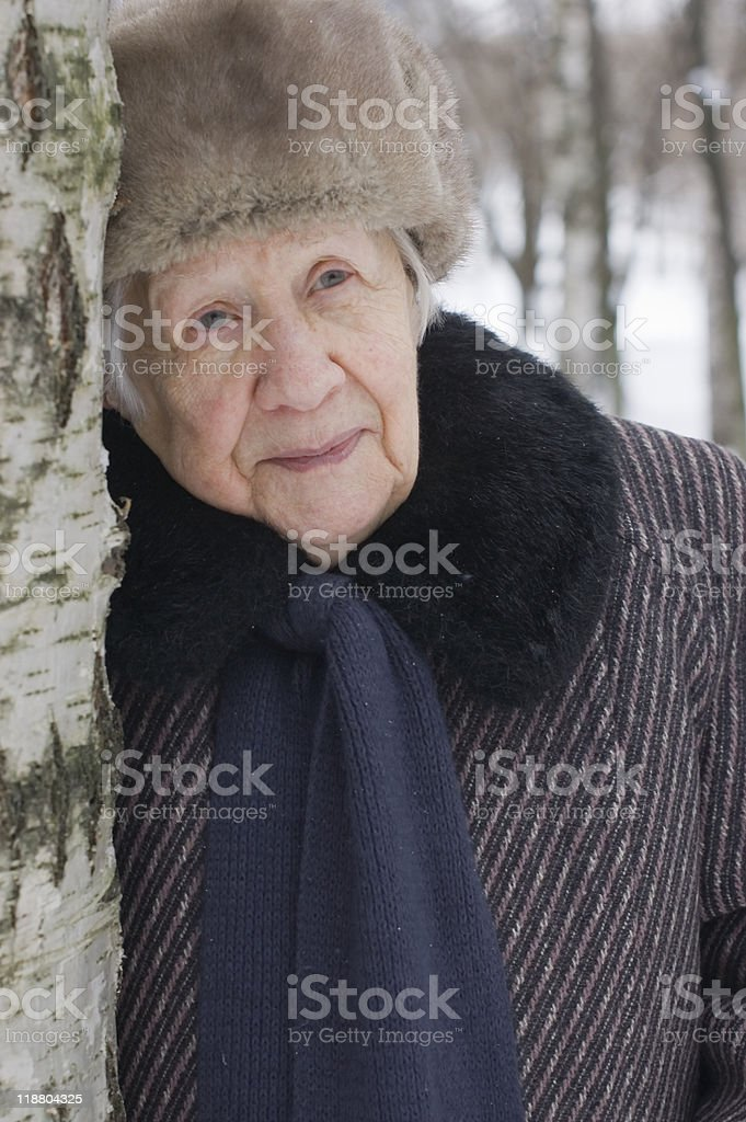 Portrait of old woman in the winter royalty-free stock photo