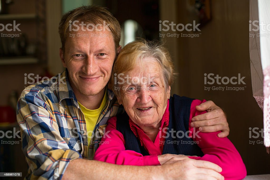 Portrait of old woman with his adult grandson. stock photo