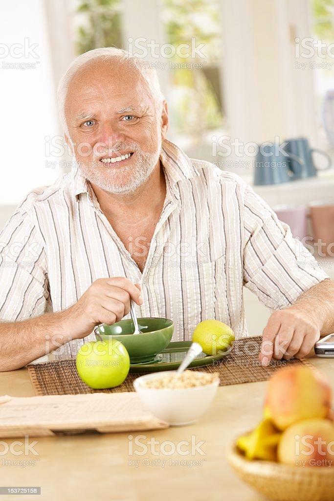 Portrait of older man having morning tea royalty-free stock photo