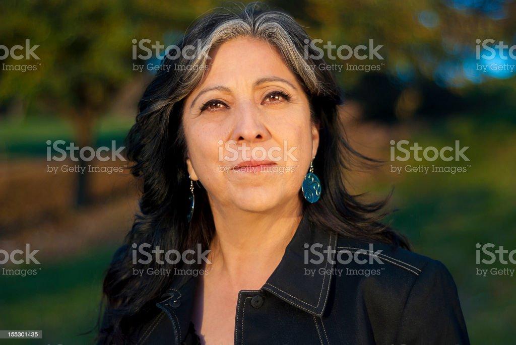 Portrait of older woman in black jacket stock photo