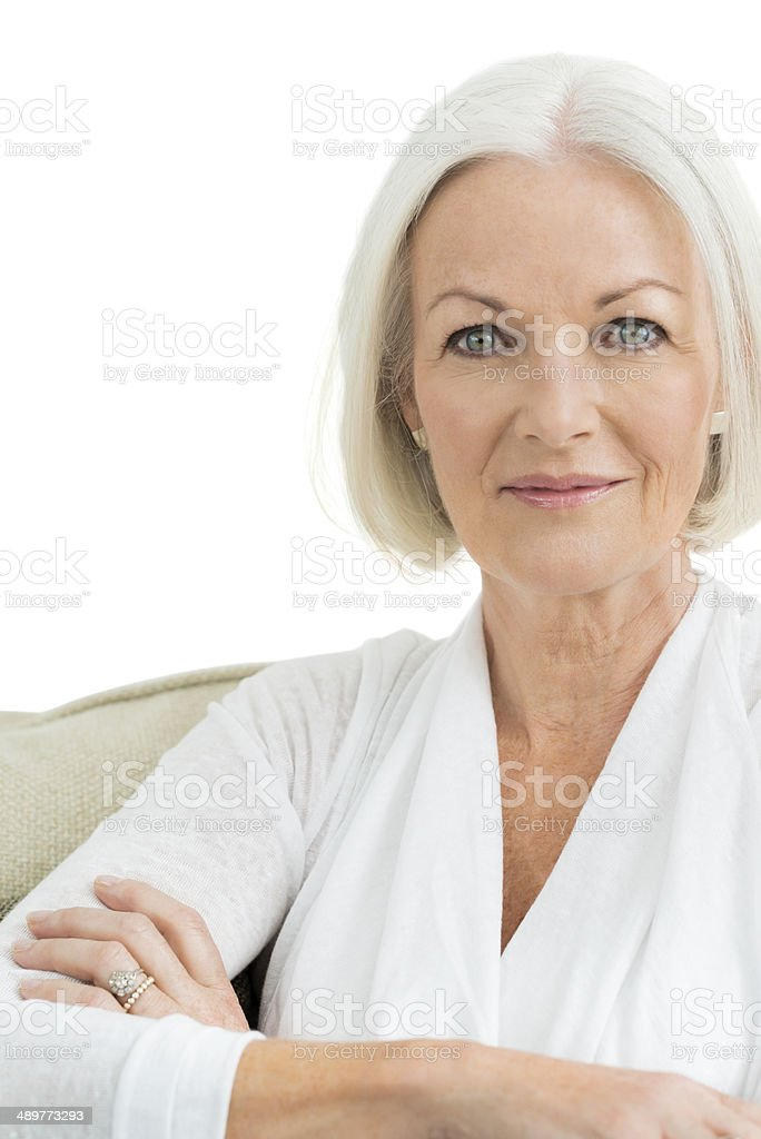 Portrait of older woman in white on white background stock photo