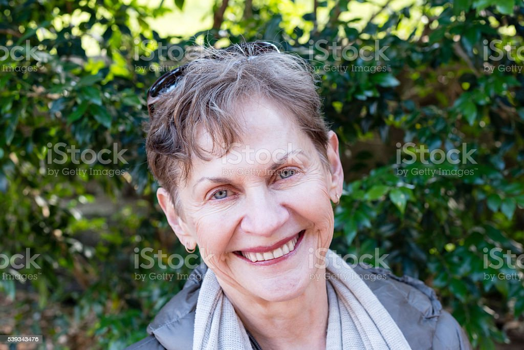 Portrait of older woman outdoors stock photo