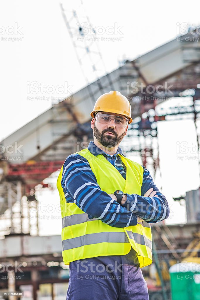 Portrait of one adult engineer with hardhat stock photo