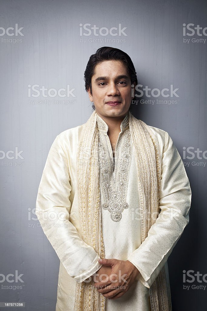Portrait of One Happy Traditional Indian Man Welcome Gesture stock photo
