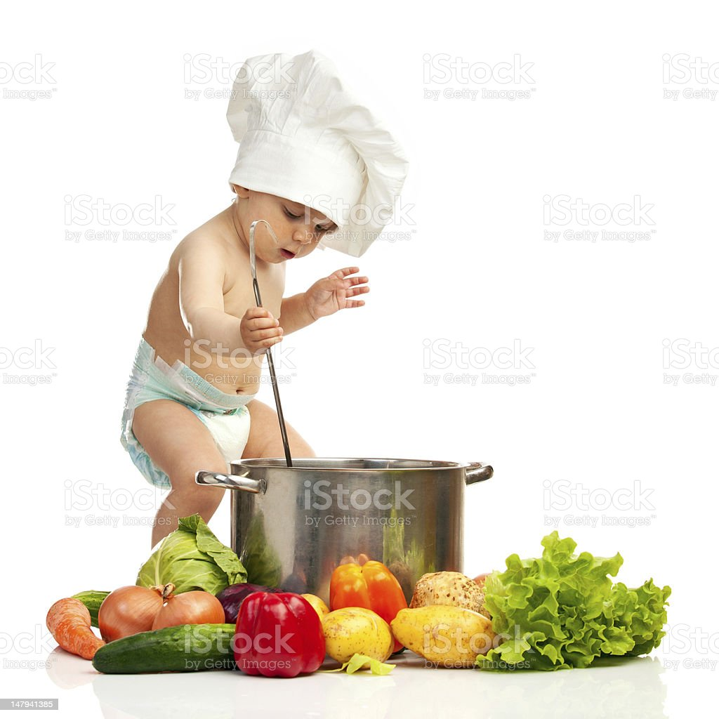 Portrait of one-year old boy in chef's hat stock photo
