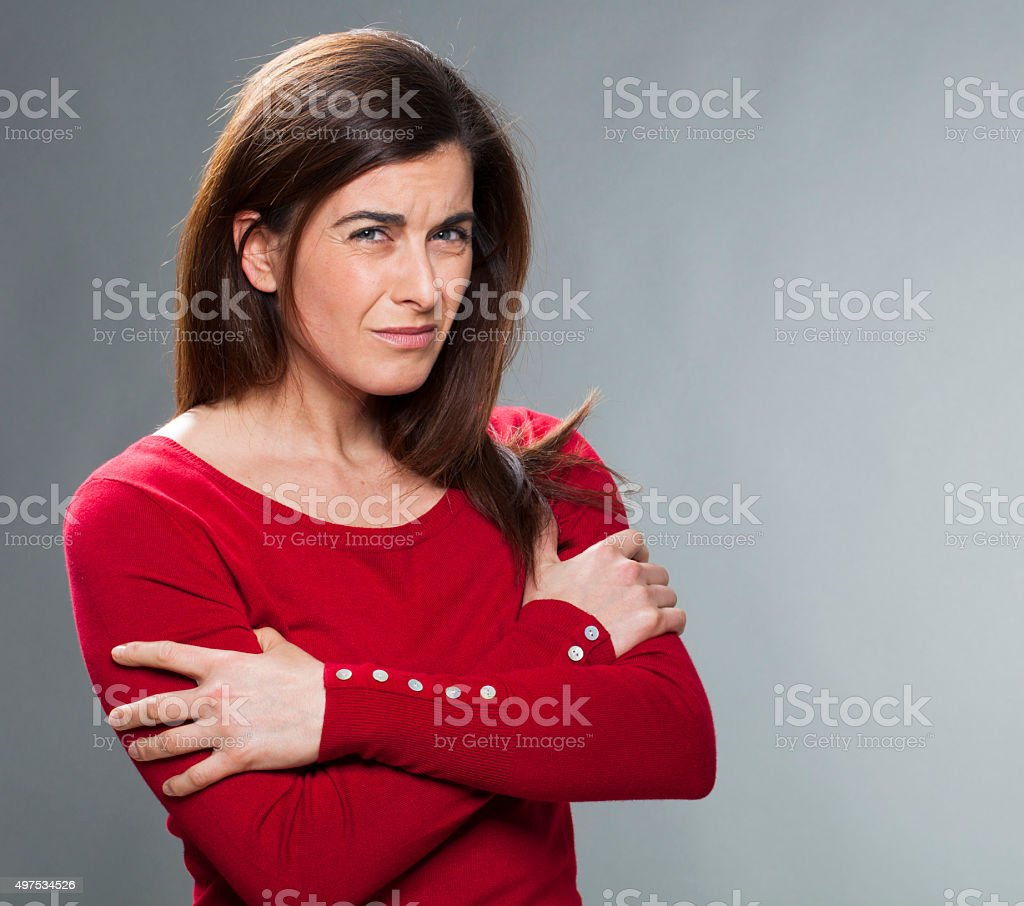 portrait of outraged brunette woman expressing rejection and fragility stock photo