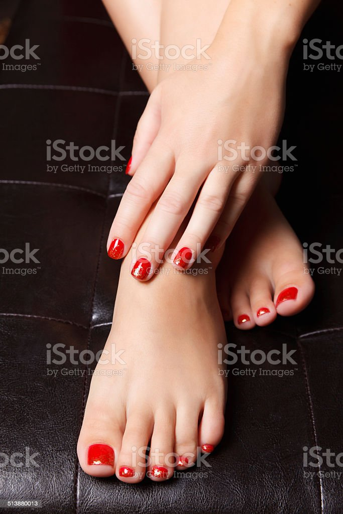 Portrait of painted nails and toes stock photo