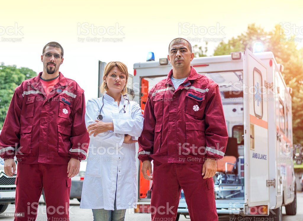Portrait of Paramedic Workers in front an Ambulance stock photo