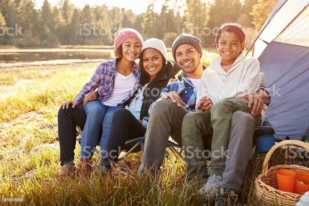 Portrait Of Parents With Children Camping By Lake stock photo