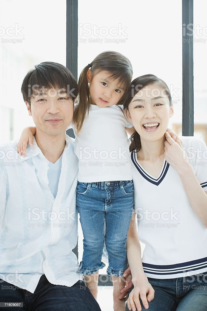 Portrait of parents with their daughter royalty-free stock photo