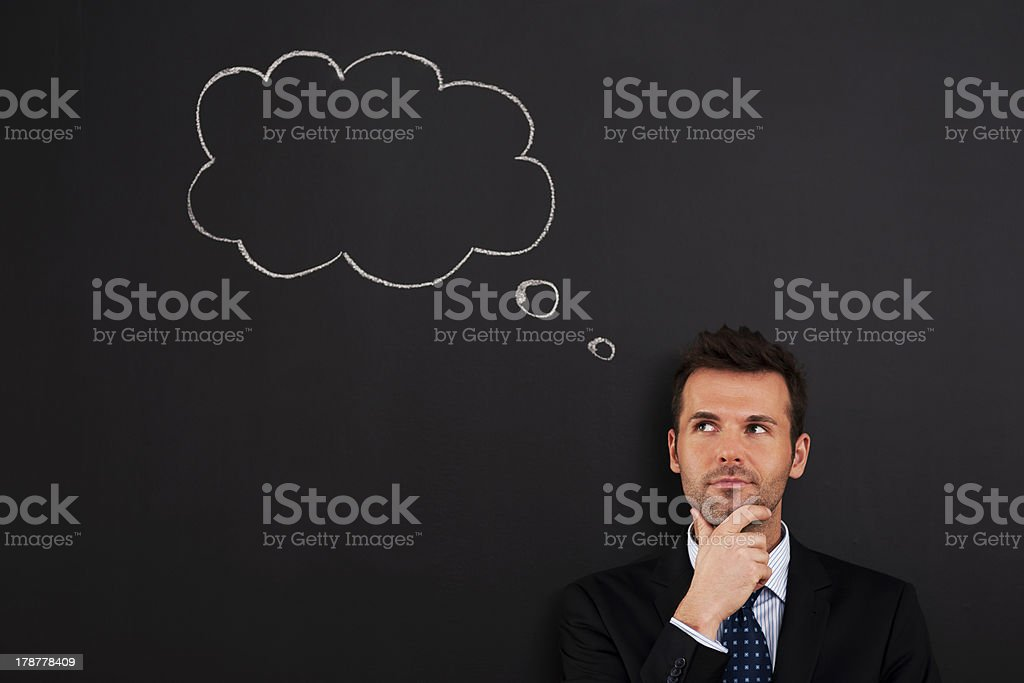 Portrait of pensive and thoughtful businessman stock photo