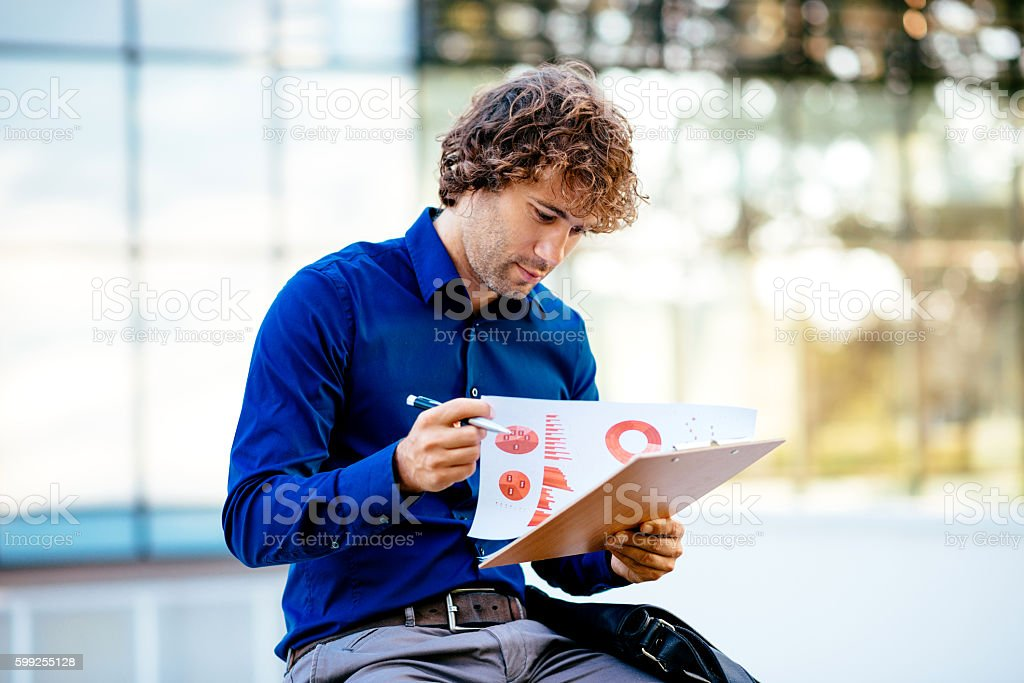 Portrait of pensive businessman dealing with financial markets stock photo