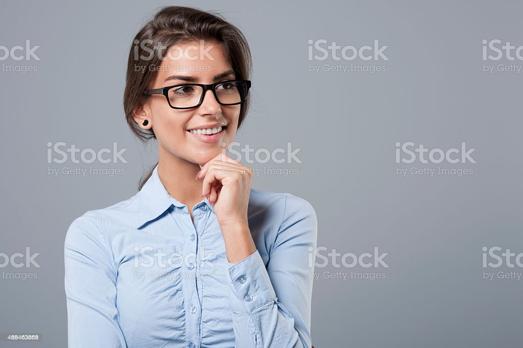 Portrait of pensive but cheerful woman stock photo