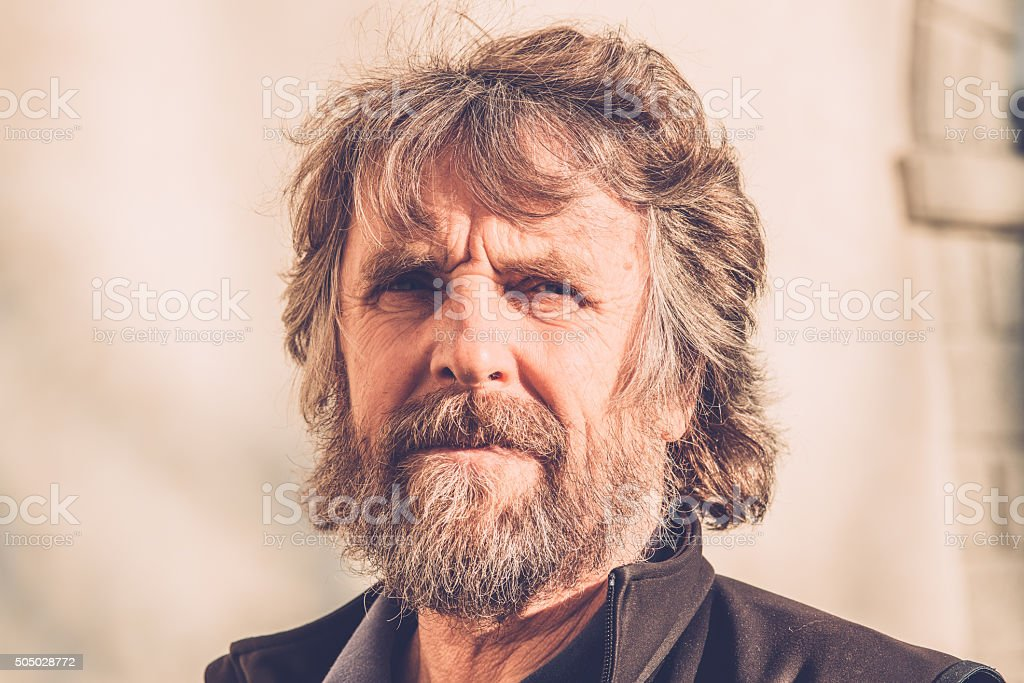 Portrait of Pensive Mature Man with Beard Outdoors, Europe stock photo