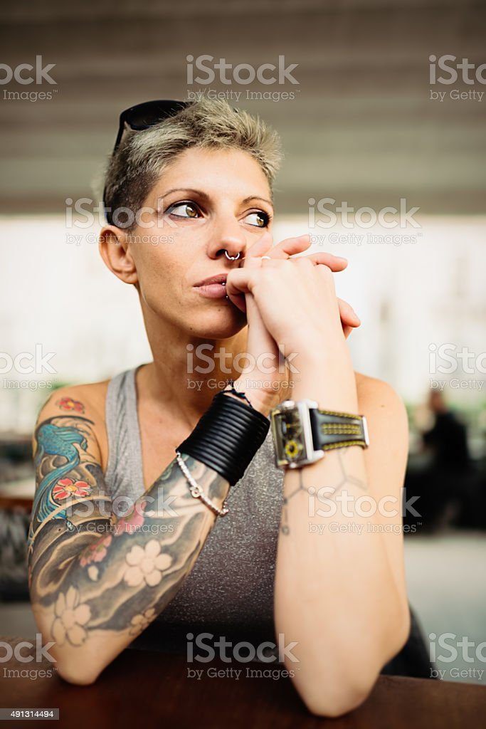 Portrait of pensive middle aged cool woman stock photo
