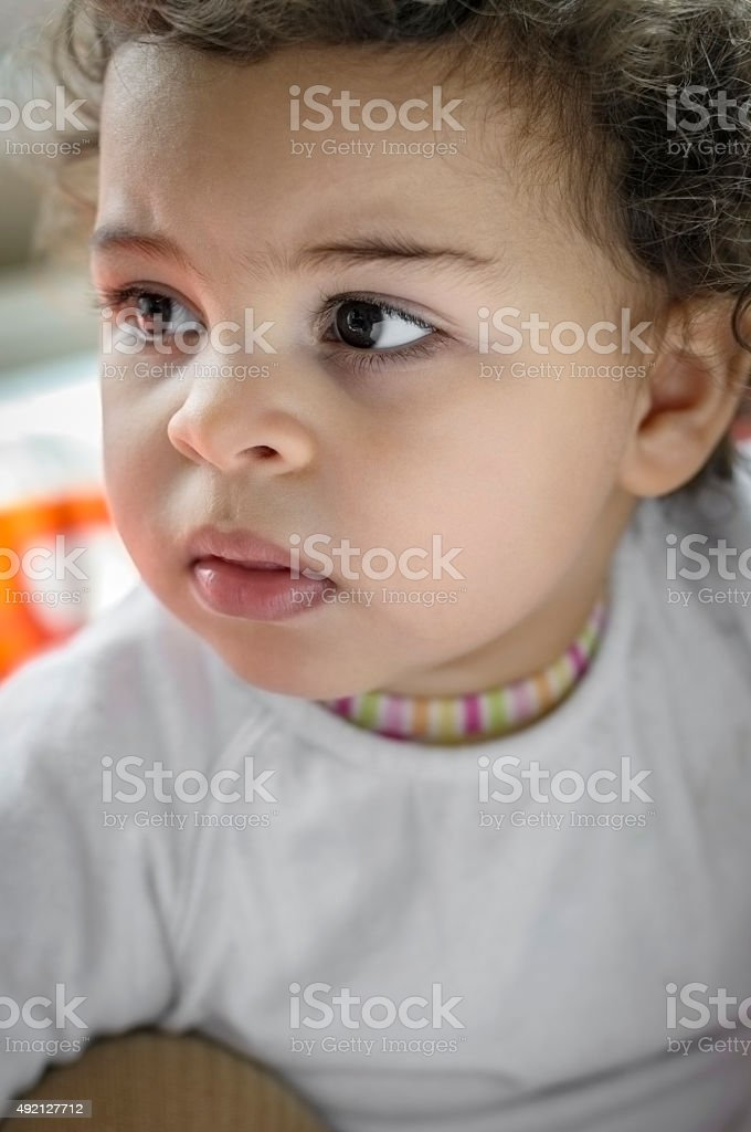 PEOPLE: Portrait of Pensive Toddler stock photo