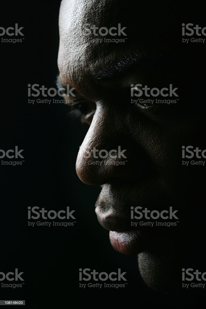 Portrait of Pensive Young Man, Low Key royalty-free stock photo