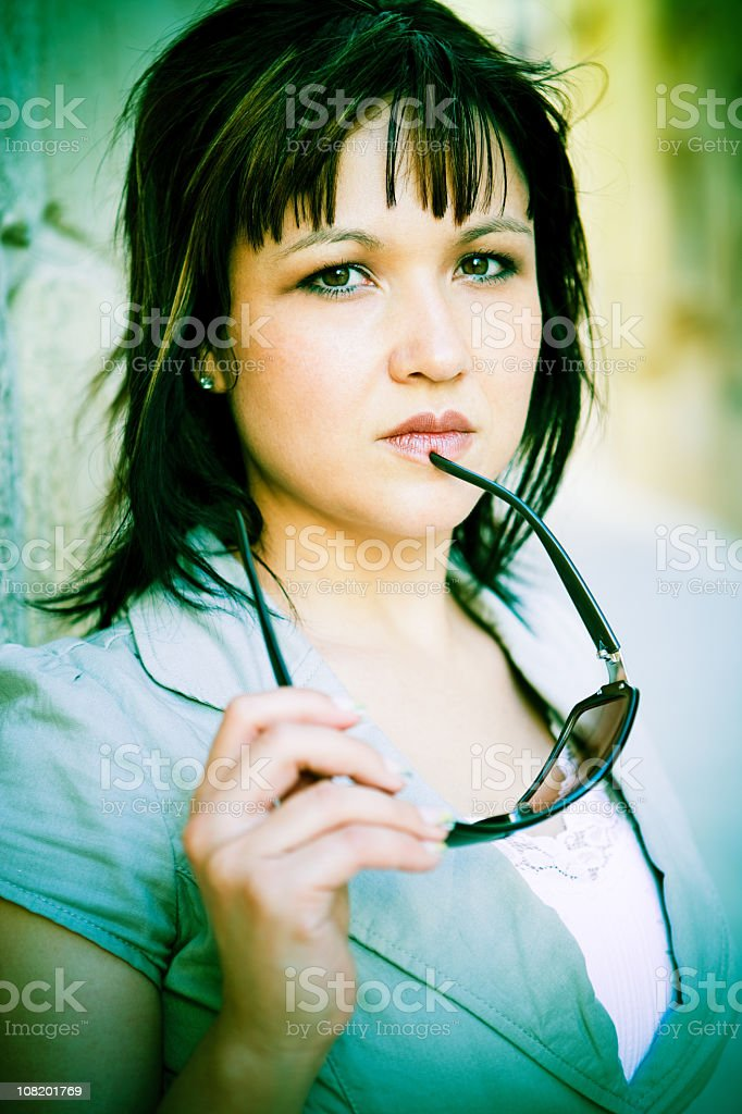 Portrait of Pensive Young Woman Holding Sunglasses royalty-free stock photo