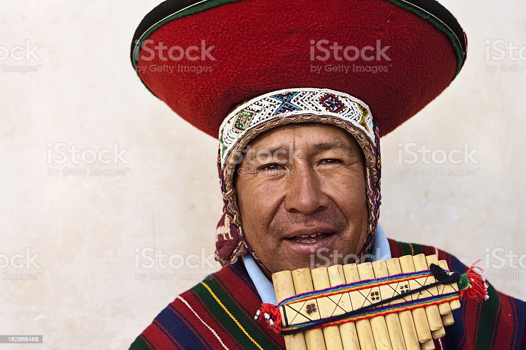 Portrait of Peruvian man playing a panflute, Sacred Valley stock photo